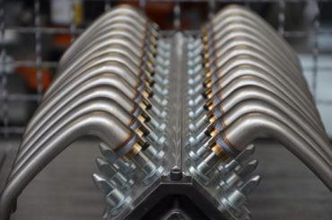 Roboter-Anlage der SHL AG sorgt für perfekte Oberflächen bei Türklinken von FSB